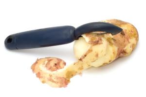 series object on white - kitchen utensil potato peeler